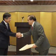 Mr. Gerard Sanvictores (R) receiving the Certificate of Commendation from Ambassador Kazuhide Ishikawa (L)