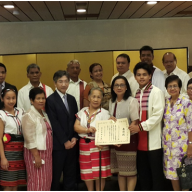 The family and friends of Dr. Mahowo who attended the conferment ceremony pose with Ambassador Ishikawa.  To the left of Atty. Tet Mahiwo is their only son, Asa Mahiwo who is now a freshman at the University of the Philippines.